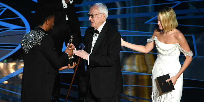 HOLLYWOOD, CA - MARCH 04:  Screenwriter James Ivory (C) accepts Best Adapted Screenplay for 'Call Me by Your Name' from actors Chadwick Boseman and Margot Robbie onstage during the 90th Annual Academy Awards at the Dolby Theatre at Hollywood & Highland Center on March 4, 2018 in Hollywood, California.  (Photo by Kevin Winter/Getty Images)